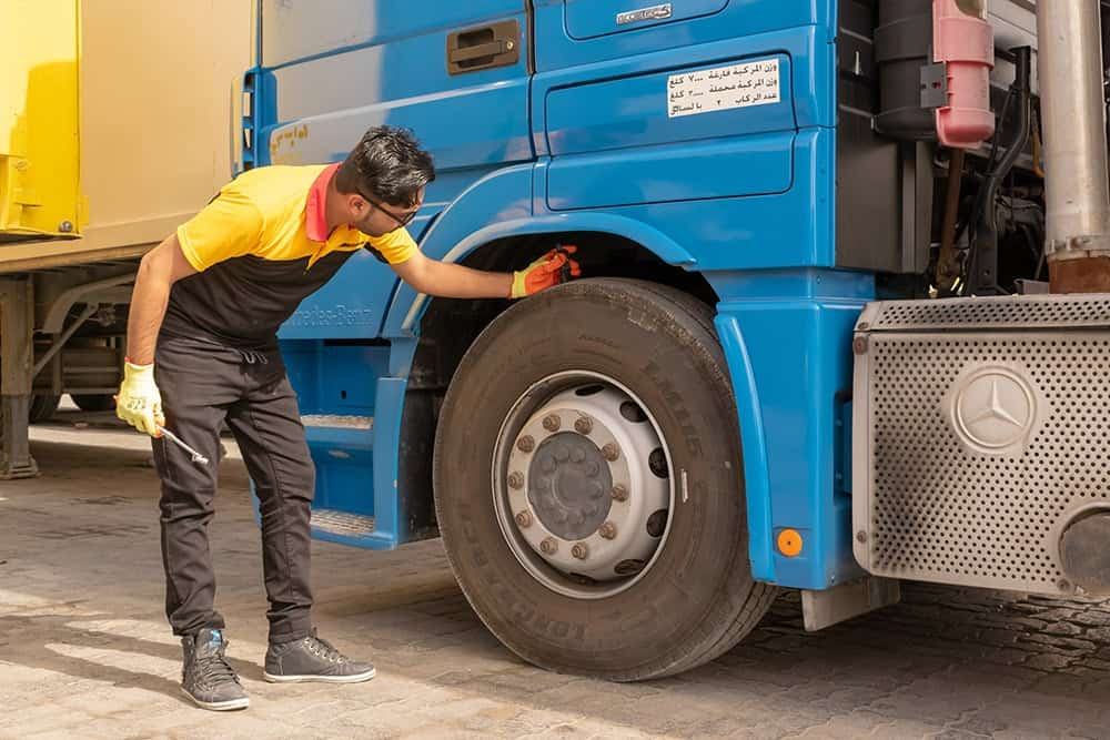 Man checking the quality of tyres